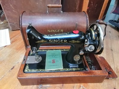 Lot 25 - A cased Singer sewing machine with all...