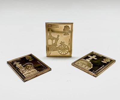 Lot 1030 - A set of seven silver-gilt replica stamps-...