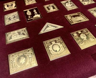 Lot 1016 - A set of 25 silver gilt replica stamps.