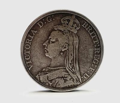 Lot 168 - A Victorian 1890 crown, a Morgan dollar 1887...