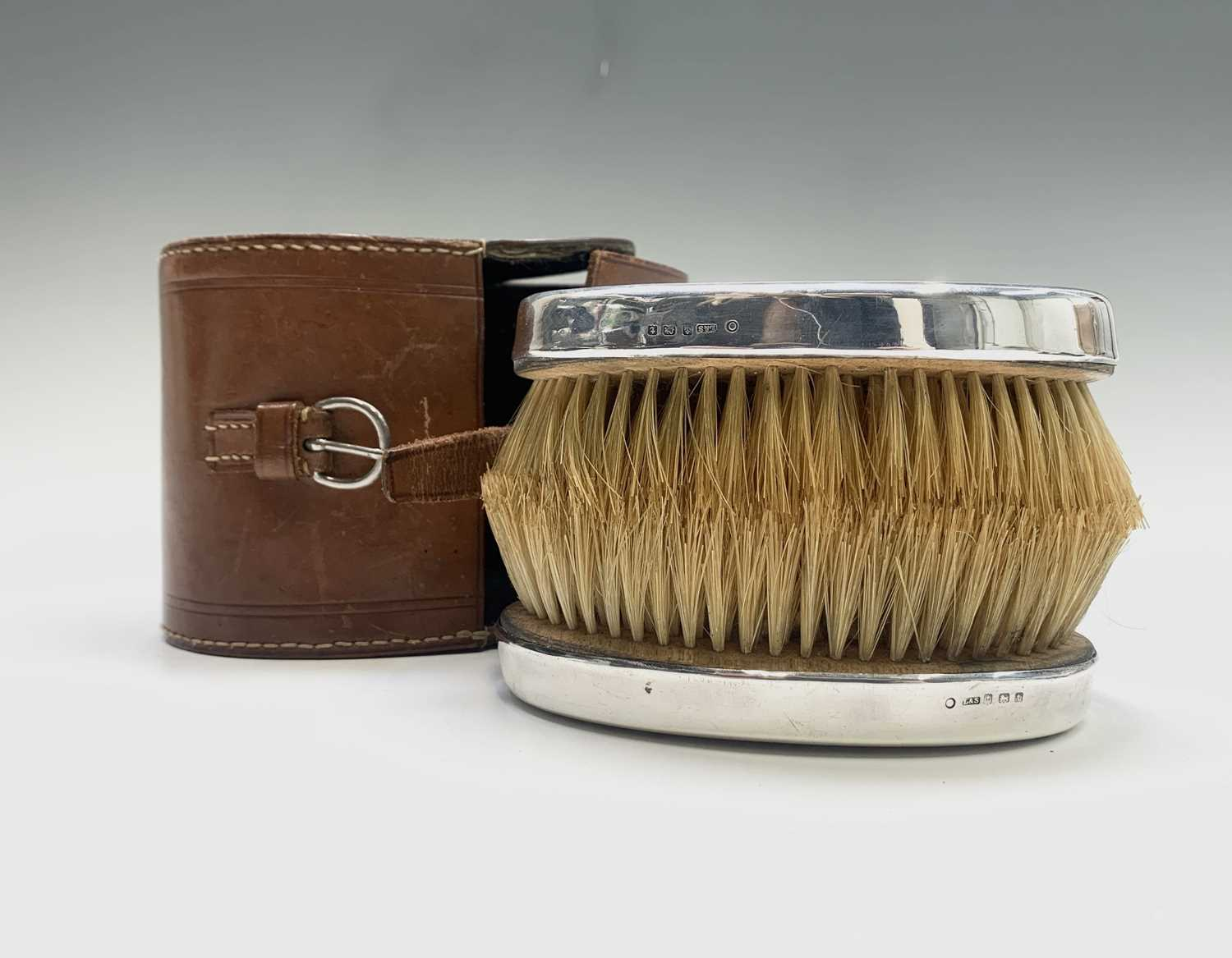 Lot 1050 - A pair of silver-mounted gentleman's brushes...