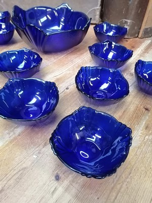 Lot 1 - A set of cobalt blue glass scalloped edged...