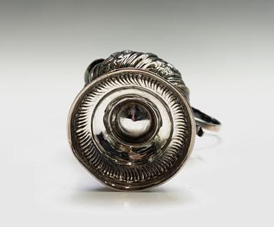 Lot 1015 - An early George III silver cream jug of pear...