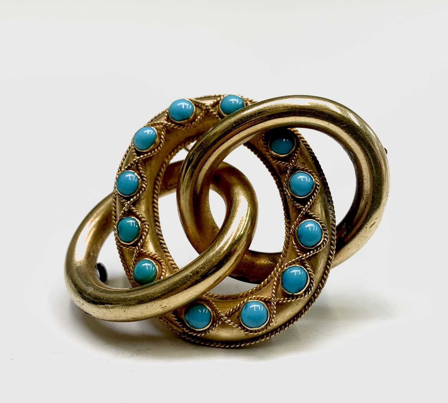 Lot 77 - A Victorian gold triple ring turquoise set...