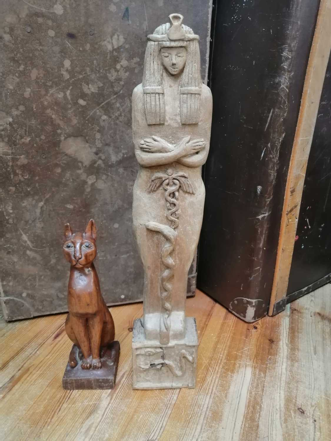 Lot 21 - Two Ancient Egyptian style wooden hand-carved...