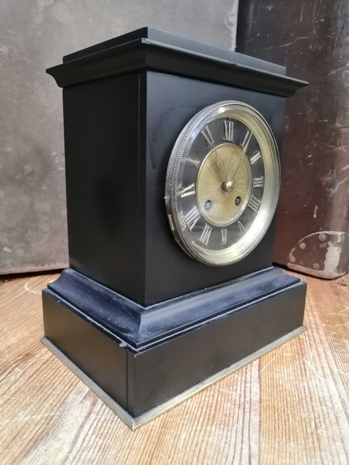 Lot 23 - A slate mantle clock.