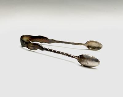 Lot 1018 - A pair of silver Edwardian sugar tongs by...