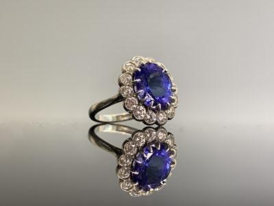 Lot 126 - A fine platinum, tanzanite and diamond oval...