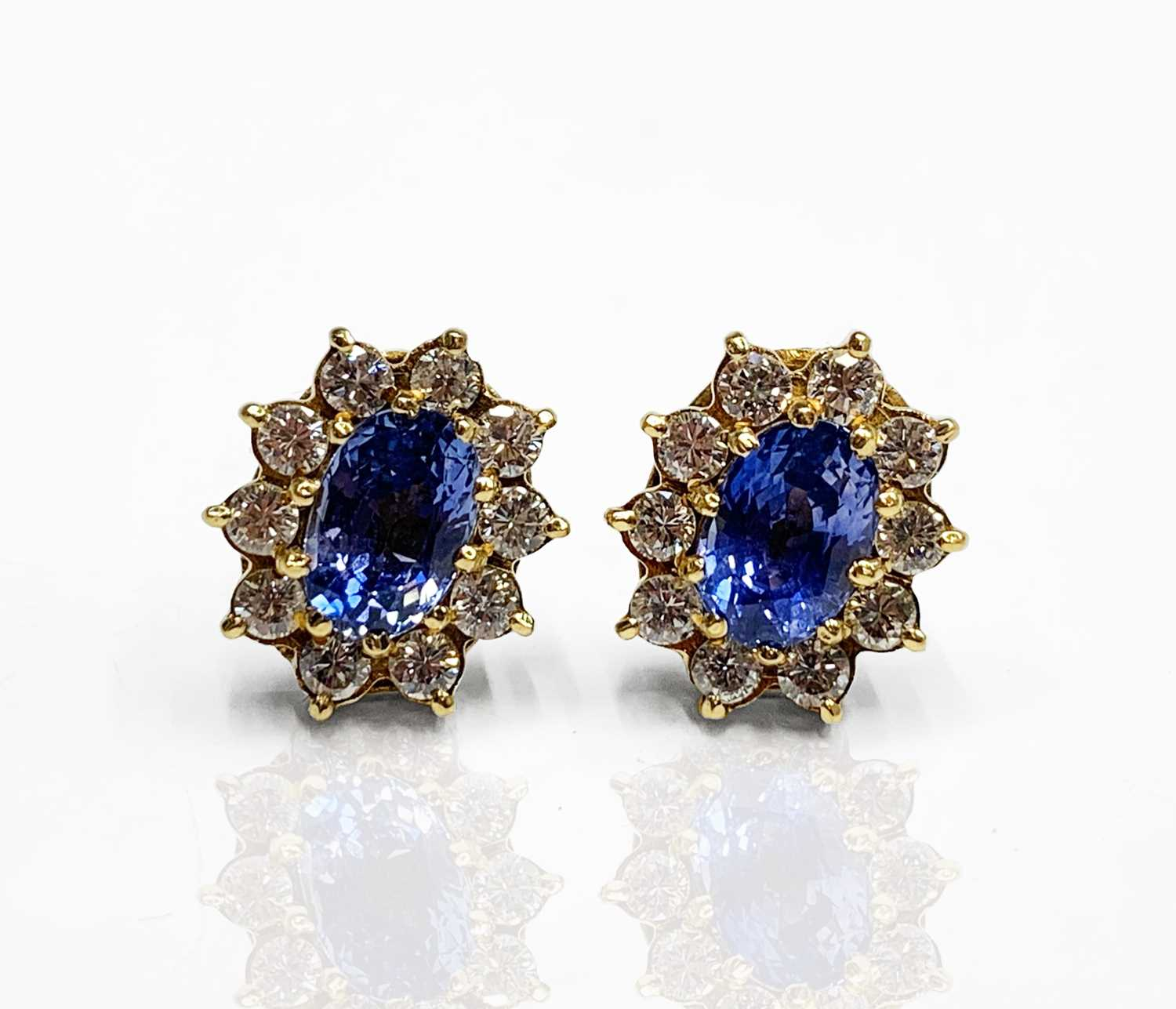 Lot 211 - A pair of good oval pale sapphire and diamond...