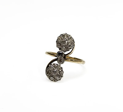 Lot 161 - An unusual Edwardian gold ring with scrolling...