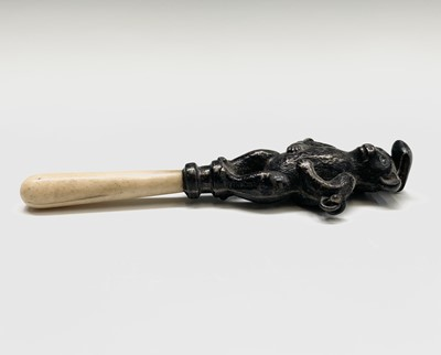 Lot 1052 - Two silver rattles, one a teddy bear the other...