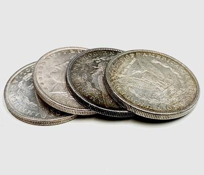 Lot 25 - USA Morgan Silver Dollars. A run of four US...