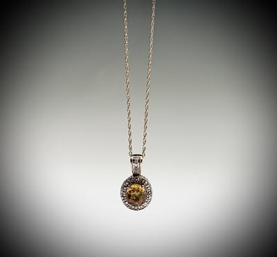 Lot 104 - A yellow sapphire (2.7cts) and diamond pendant...
