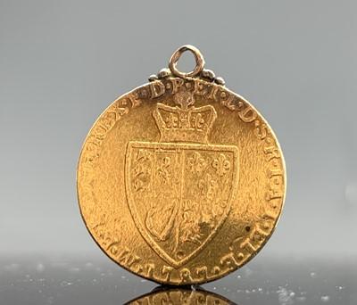 Lot 21 - A George III Spade guinea 1787 mounted as a...