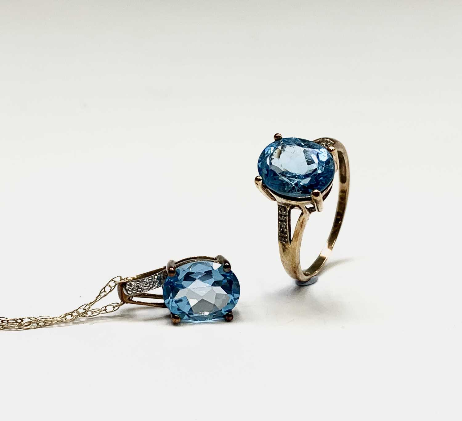 Lot 205 - A 9ct gold blue topaz and diamond ring...