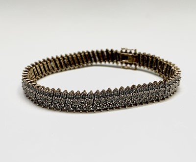 Lot 119 - A 9ct gold bracelet set with over 200 small...