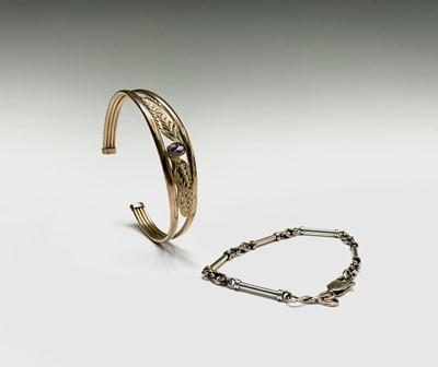Lot 107 - A 9ct gold bracelet and a 9ct gold bangle set...