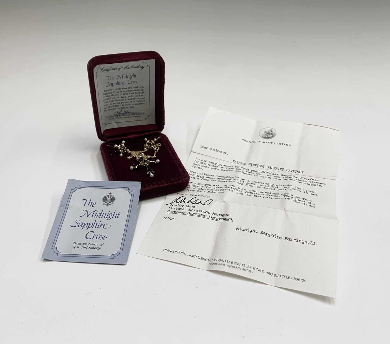 Lot 75 - An Igor Faberge 14ct gold and enamel cross set...