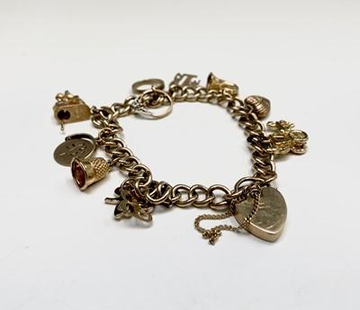 Lot 132 - A 9ct gold charm bracelet 29.9gm
