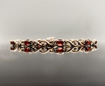Lot 147 - A 9ct gold diamond and ruby bracelet 5.5gm