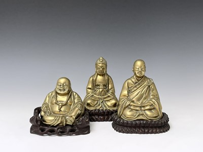 Lot 316 - Three Chinese brass buddahs, early 20th...