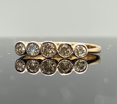 Lot 32 - A gold ring set with five graduated diamonds 2gm