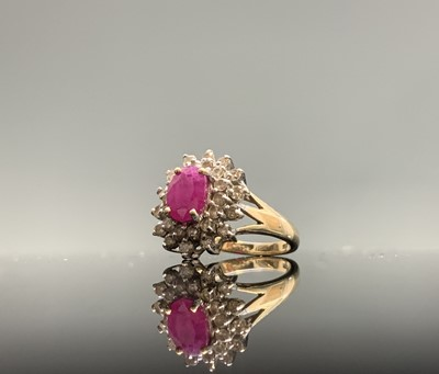 Lot 115 - A 9ct gold ring with an oval ruby and diamond...