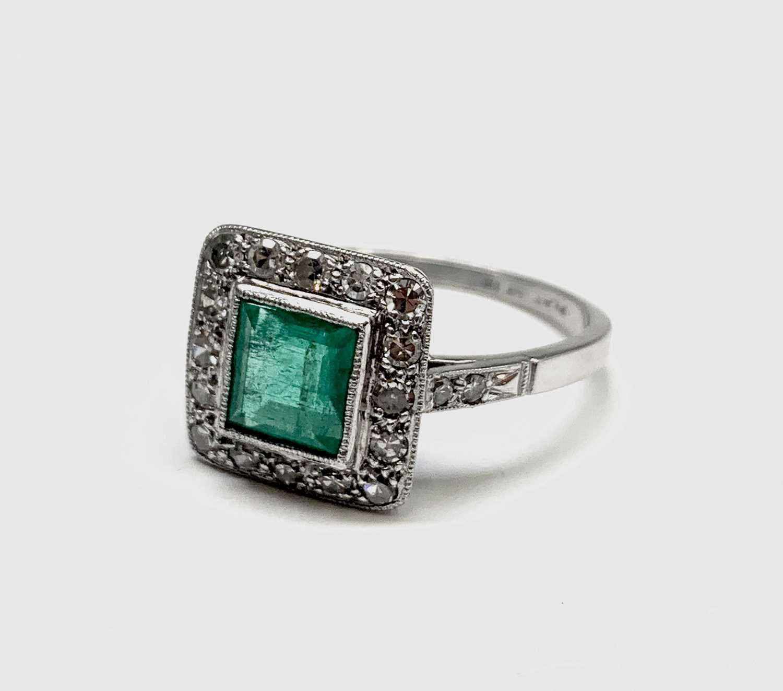 Lot 53 - A platinum emerald and diamond square ring 4.2gm