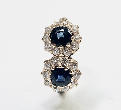 Lot 19 - A yellow gold double diamond and sapphire...