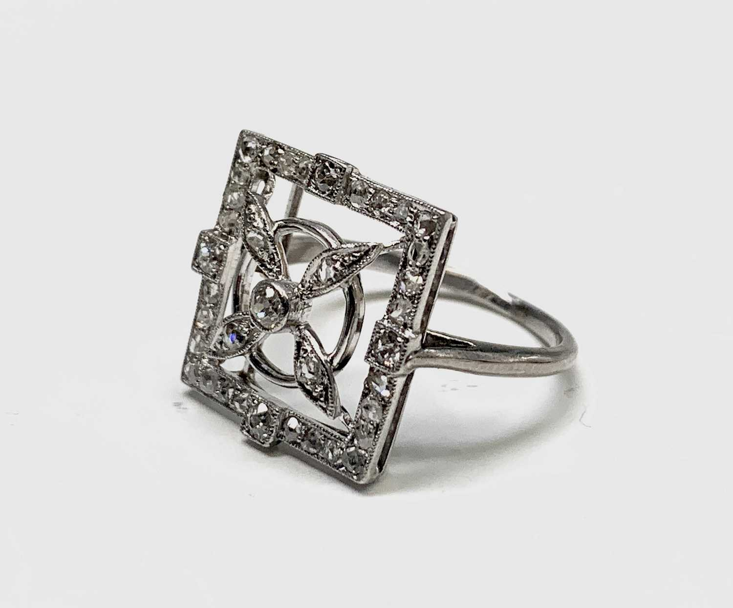 Lot 251 - An unusual white gold or platinum 1920s ring...