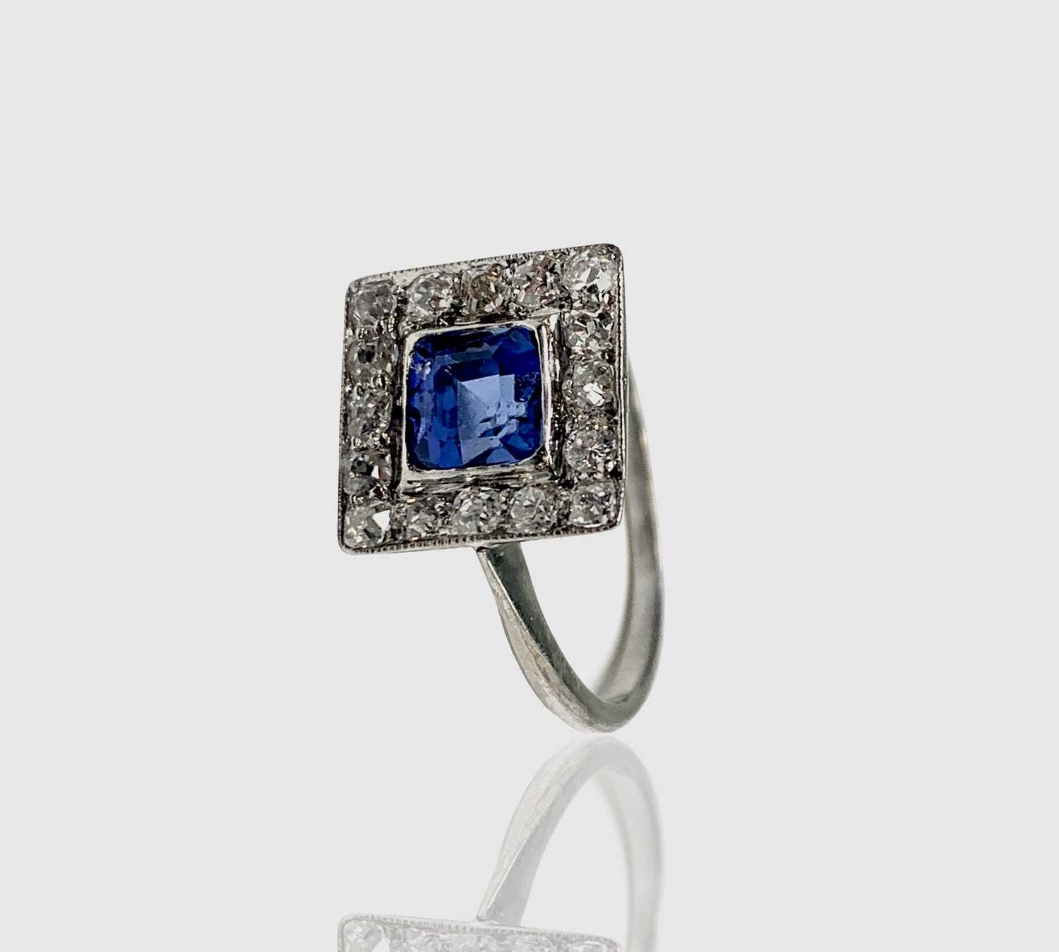 Lot 62 - A white gold or platinum sapphire and diamond...