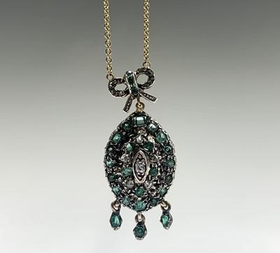 Lot 191 - An emerald and diamond pendant Ht 34.25mm 6gm