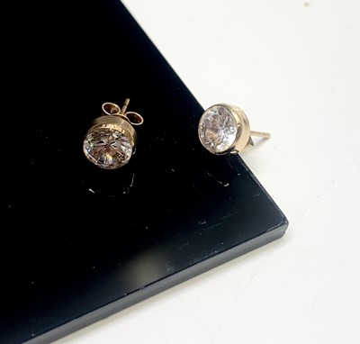 Lot 171 - A pair of white stone set ear studs