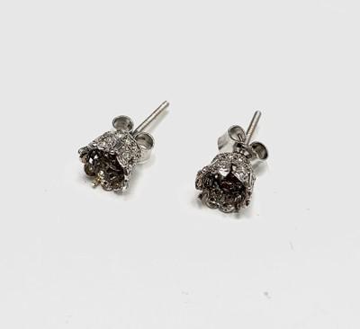Lot 121 - A pair of platinum, diamond-set crown...