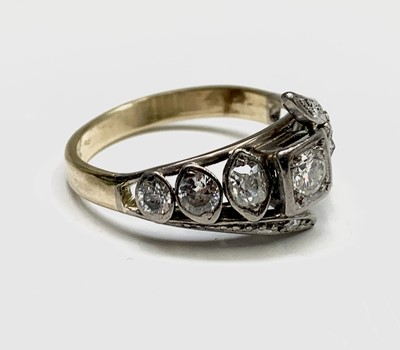 Lot 87 - An antique style gold ring set with navette...