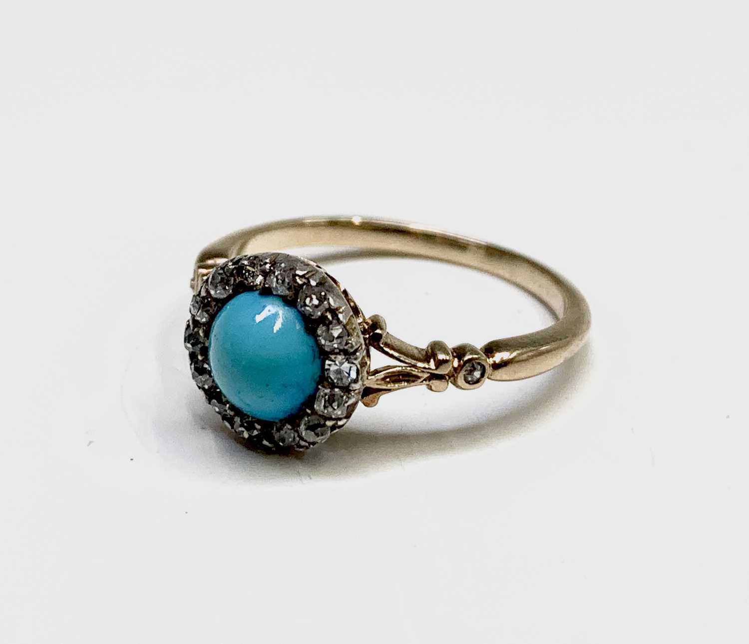 Lot 231 - A Victorian gold turquoise and diamond cluster...