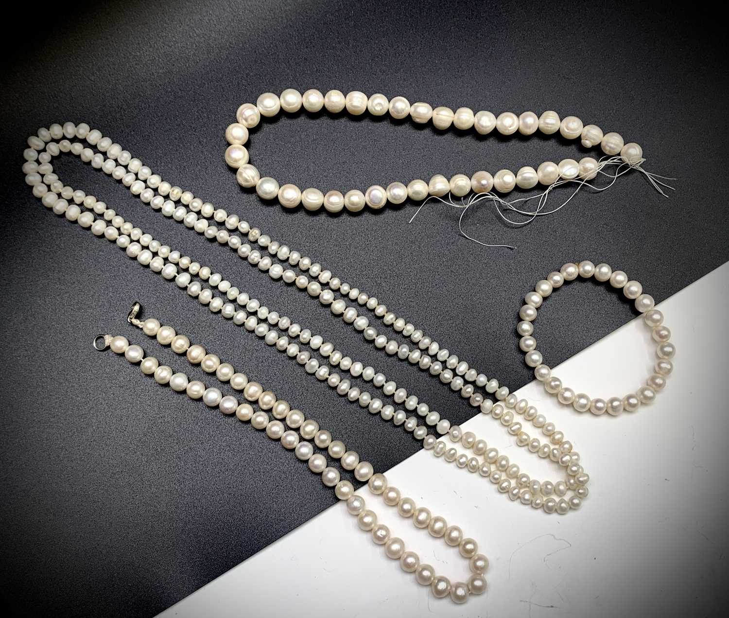 Lot 24 - Cultured pearls - three necklaces and a...