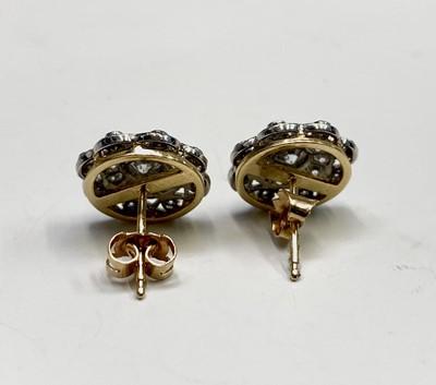 Lot 195 - A pair of Belle Epoch diamond set discus...