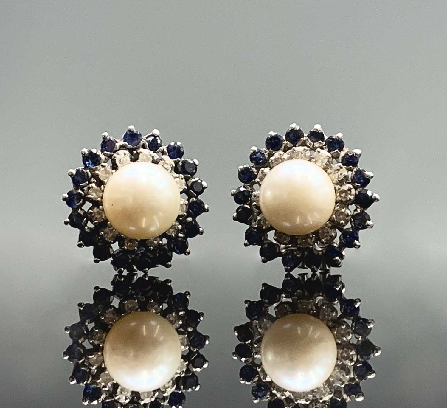 Lot 80 - A pair of 18ct white gold earrings each with a...