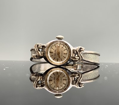 Lot 62 - A 9ct white gold diamond set cocktail watch by...