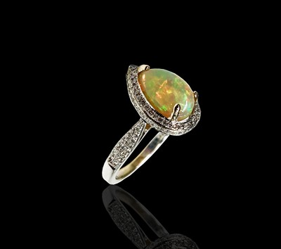 Lot 133 - An 18ct white gold ring set a pear shape opal...