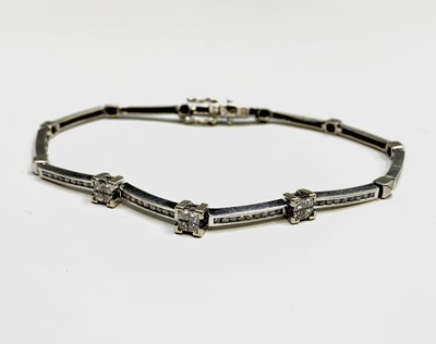 Lot 154 - A 9ct white gold line bracelet set with...