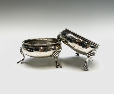 Lot 1074 - A pair of George III open salts with beaded...