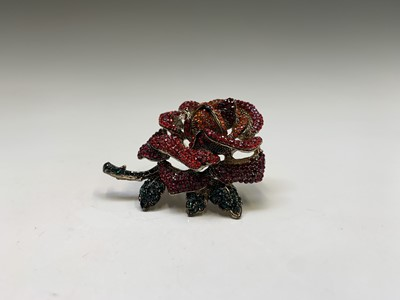 Lot 186 - A costume jewellery, red rose crystal brooch...