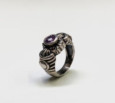 Lot 190 - A modern silver ring with an amethyst in...