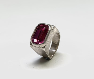 Lot 44 - A signet style silver ring set a fuchsia pink...