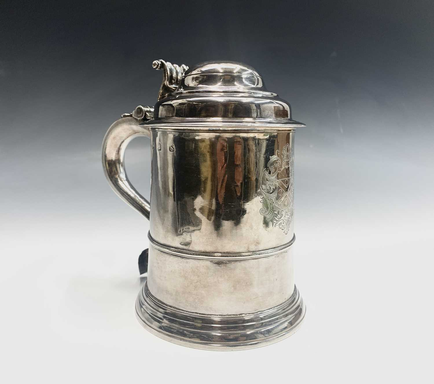 Lot 1062 - A George II English silver straight-tapered...