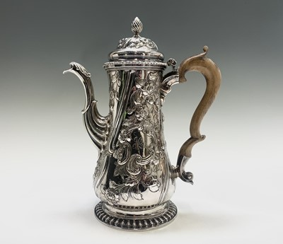 Lot 1006 - A George II coffee pot with wooden handle and...