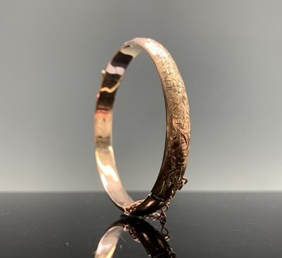 Lot 235 - A chased 9ct gold hinged bangle 9.4gm