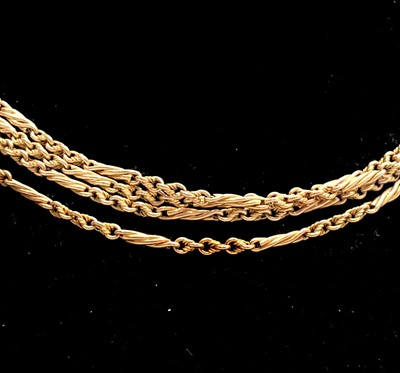 Lot 208 - A 10ct gold long guard with spiral bar links...